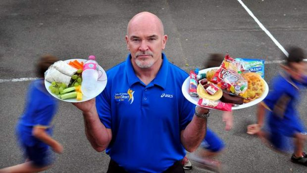Rob de Castella stands in the Giralang Primary school yard and display's in his left hand a plate of healthy affordable ...