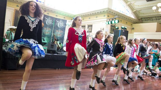 The Queensland Irish Dancing Association dancers perform at the Irish Club after the St Patrick's day Parade in Brisbane ...