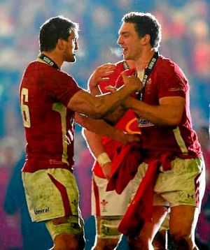 Wales teammates Sam Warburton (L) and George North (R) celebrate winning the Six Nations Championship.