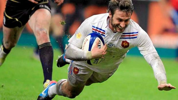 Maxime Medard scores the match-sealing try for France.