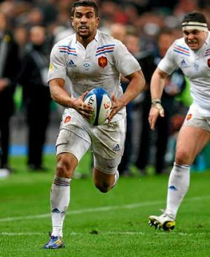 Wesley Fofana of France runs away to score the first try.