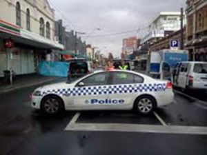 Police block traffic on Johnston Street, Fitzroy at the weekend.