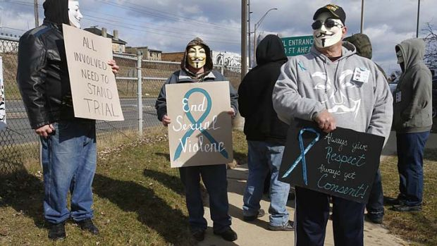 A group of protesters in Anonymous masks outside court in Steubenville.