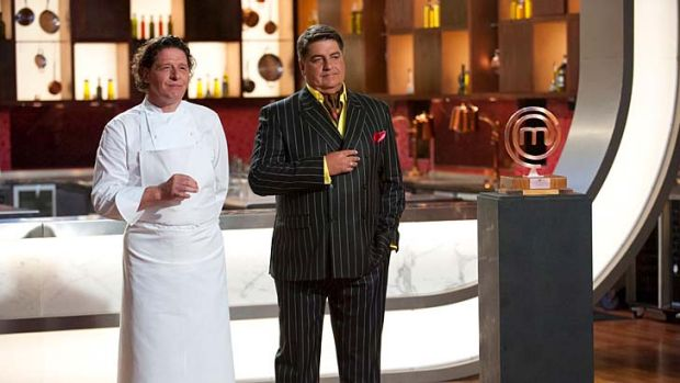 Pierre White and Matt Preston with the <em>Masterchef: The Professionals</em> trophy.