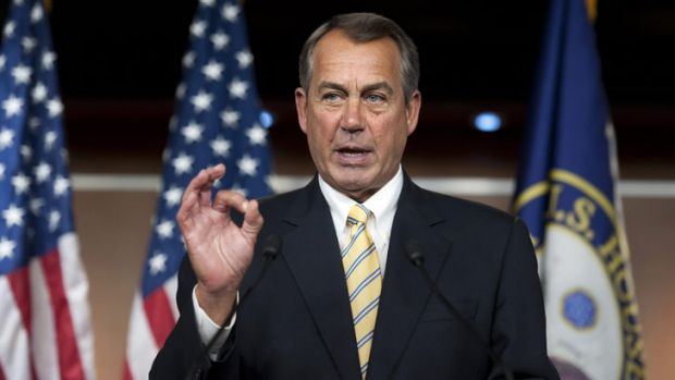 """US House Speaker John Boehner ... makes a """"zero"""" gesture as he speaks with reporters about the federal budget."""
