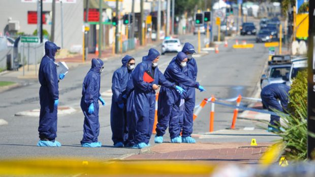 Forensic officers examine the scene.