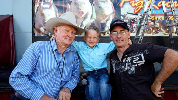 Three generations: Tom Vandeleur (left), his son Mike (right) and grandson Mater, 5, run the pig-diving.