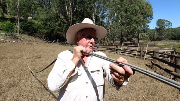 Interrupted service: Bob Bolin holds up a Telstra phone cable knocked down before Christmas.