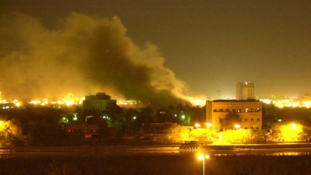 Smoke rises over Baghdad: One of Saddam Hussein's palaces on the Tigris River burns after a missile strike during the ...