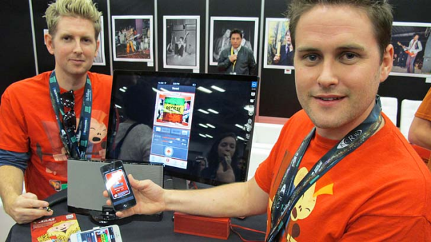 Joseph (L) and Sam Russell, brothers from Melbourne, Australia, show off their Jam smartphone app on March 14, 2013 at ...