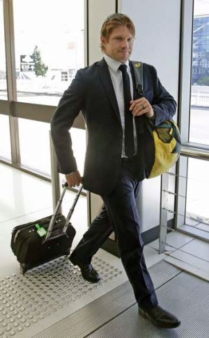India calling: Shane Watson at Sydney airport on Monday.