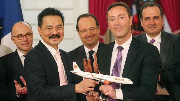 Biggest civilian deal in the history of Airbus ... CEO of Lion Air Rusdi Kirana of Indonesia, left, and CEO of Airbus, ...
