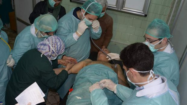 A Syrian injured during an alleged chemical attack at Khan al-Assal is treated by doctors at a hospital in Aleppo.