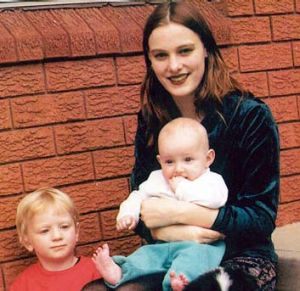 Missing for more than 13 years: Belinda Peisley, pictured with her two children.