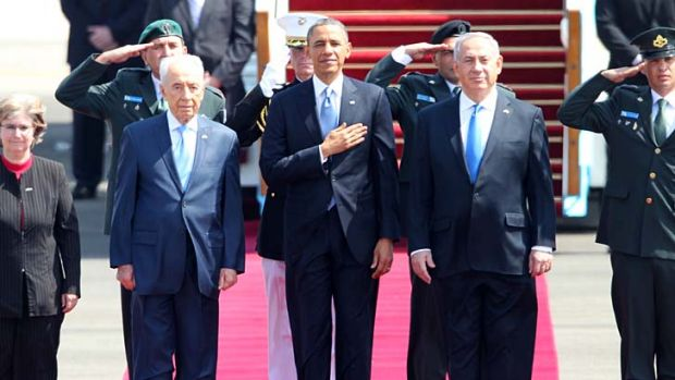 Red carpet treatment: Mr Obama with Israeli Prime Minister Benjamin Netanyahu (right) and President Shimon Peres.