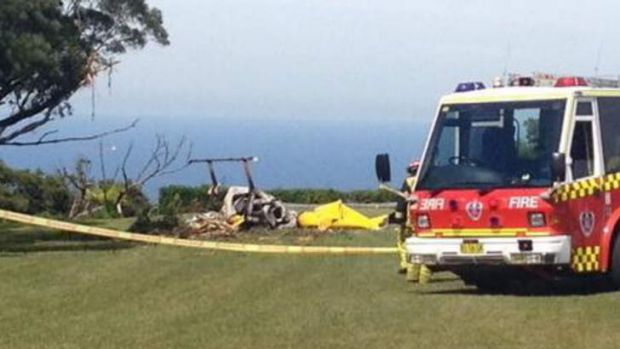Fire and rescue workers arrive at the scene of a fatal helicopter crash at Bulli Tops.