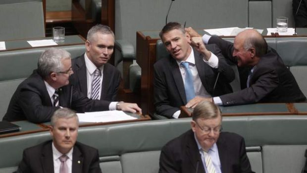 Independent MPs Andrew Wilkie, Craig Thomson, Rob Oakeshott and Tony Windsor talk during the motion of no confidence ...