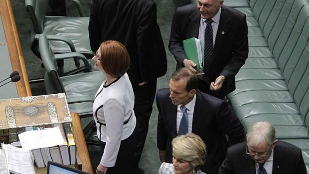Prime Minister Julia Gillard and Opposition Leader Tony Abbott during question time at Parliament House.