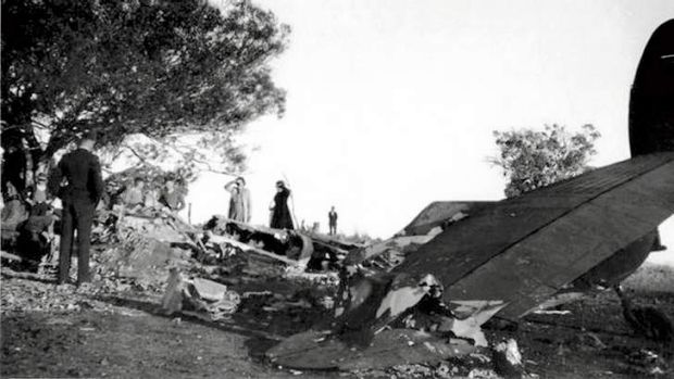Surveying the damage … Canberra residents examine the wreckage of A16-97.