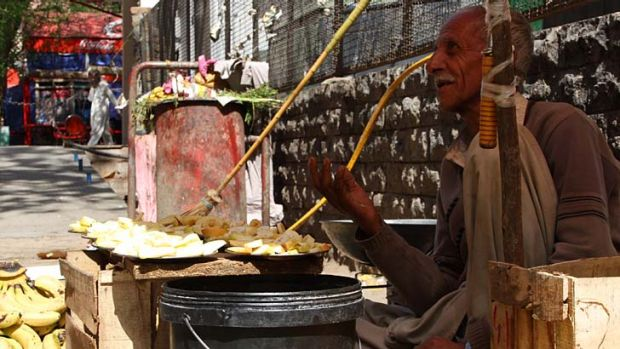 Hope rather than expectation: Pakistani roadside fruit vendor Gufoor Ahmad.