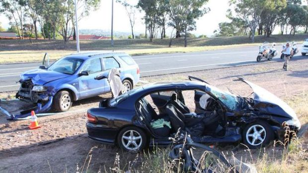 A seriously injured man was trapped inside his burning vehicle after it was hit by the driver of a stolen car in Kambah.