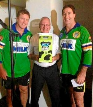 Raiders coach David Furner (left) with club legend Bradley Clyde (right) wearing old Canberra jerseys to help launch ...