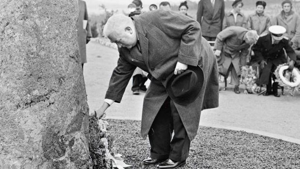 Lest we forget … Prime Minister Robert Menzies places a wreath on the memorial cairn to the air disaster at Fairbairn, ...