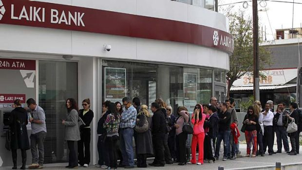 Huge queues outside a branch of Laiki Bank in Nicosia.