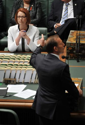 Question time: Tony Abbott has the floor, but Julia Gillard has other issues pending.