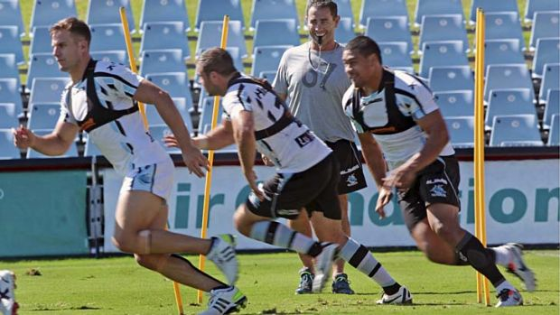Business as usual: Shane Flanagan trains his squad for the first time since being reinstated.