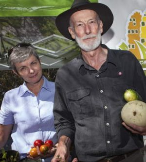 Virginia Proust and Keith Colls from the Canberra City Farm Society celebrating the Harvest Festival.