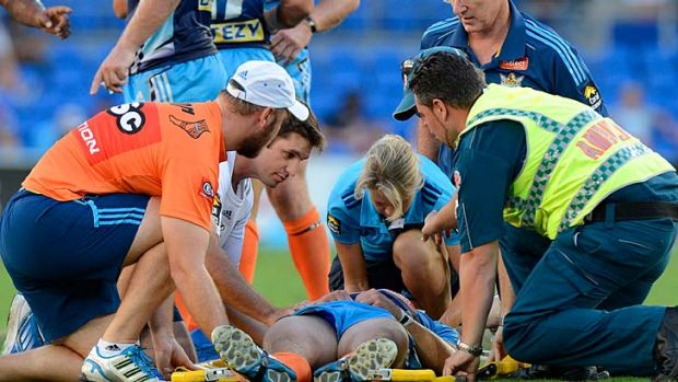 Ashley Harrison of the Titans is knocked out after being hit late by Richie Fa'aoso of the Sea Eagles.
