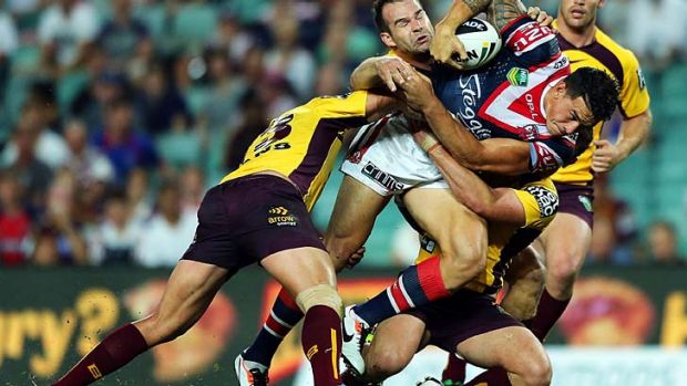 Sonny Bill Williams of the Roosters takes on the Broncos' defence.