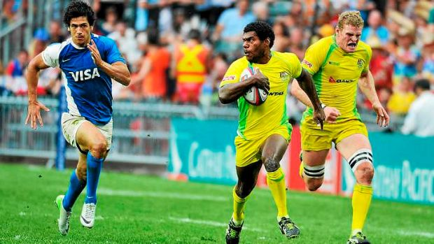 Shannon Walker of Australia streaks away from the Argentina defence.