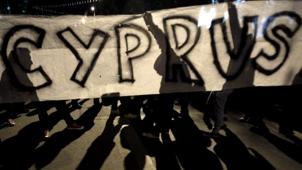 Euro zone crisis ... protesters hold a banner during an anti- bailout rally outside of European Union house in capital ...