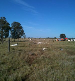 The plane crashed two kilometres from Roma Airport, with the force of impact leaving a mangled wreck.