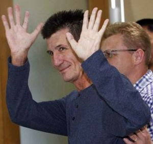 Freed: Warren Rodwell waves after a brief news conference upon his arrival at the Manila International airport.