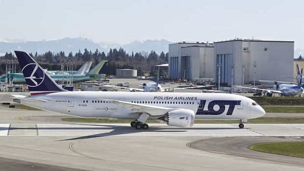 Test flight ... a LOT Polish Airlines Boeing 787 Dreamliner, with a redesigned lithium ion battery, prepares to take off.