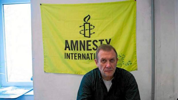 Amnesty International Russia chief, Sergei Nikitin, in his office in Moscow on Monday after the raid.