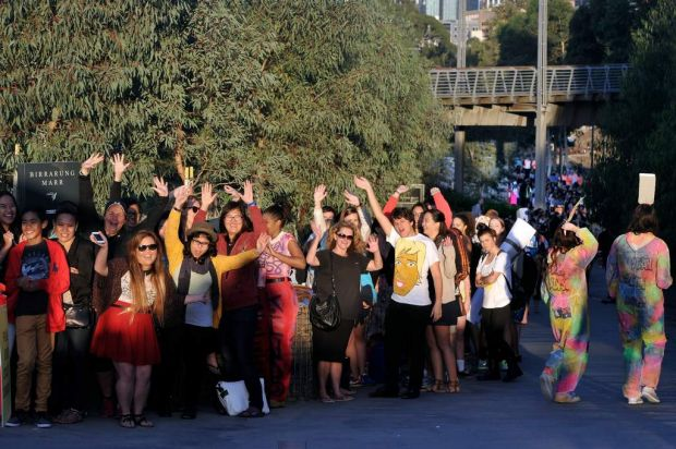 Fans queuing to be part of the <i>Ellen</i> action at Birrarung Marr, Melbourne.