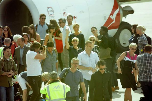 Ellen DeGeneres and Portia de Rossi arrive at Tullamarine airport in Melbourne on Monday.