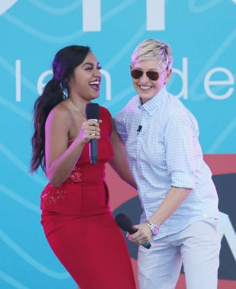 Ellen DeGeneres, right, gets her groove on with singer Jessica Mauboy at Birrarung Marr.