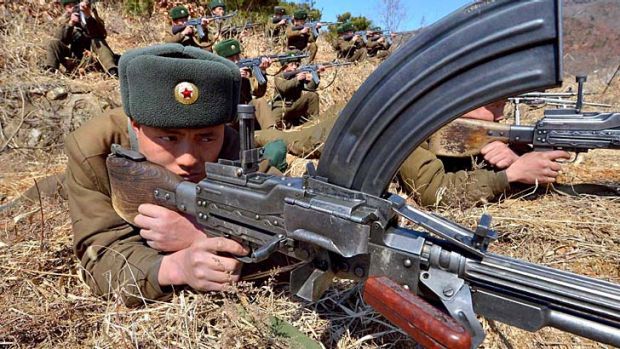Threatening strikes: Korean People's Army soldiers train at an undisclosed location in North Korea.
