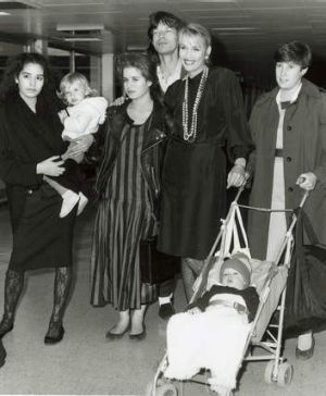 Hall and Mick Jagger in 1986 with their children and stepchildren Karis, Elizabeth, Scarlett, Jade and baby James.