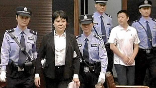 Chinese whispers … Gu Kailai and Zhang Xiaojun (at right) are escorted into court in August 2012.