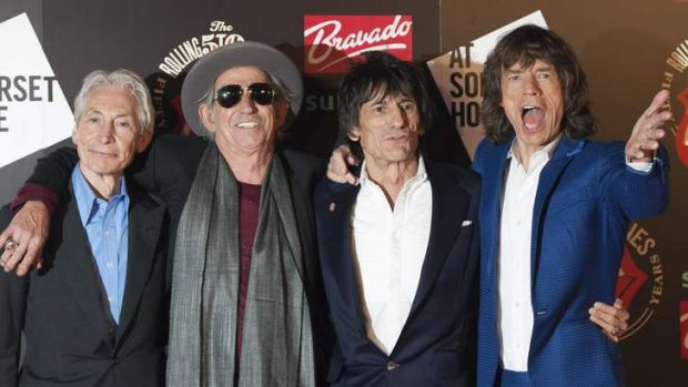 The Rolling Stones, from left, Charlie Watts, Keith Richards, Ronnie Wood and Mick Jagger will play Britain's ...
