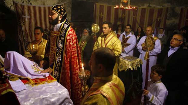 Holy place: The Syriac Orthodox community attend a mass during Lent in Jerusalem's Church of the Holy Sepulchre.