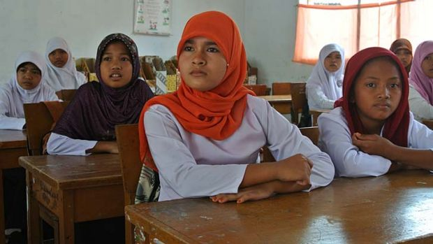 Uphill battle: Children at school in northern Padang, Indonesia, are ignorant about what to do in an earthquake despite ...