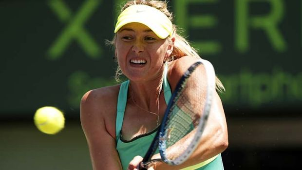 Maria Sharapova in action against Jelena Jankovic of Serbia at the Sony Open tennis tournament in Key Biscayne, Florida.