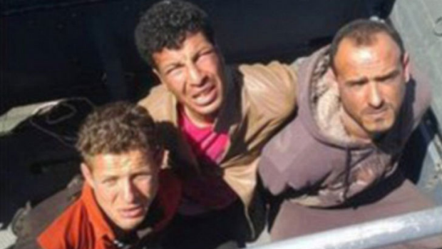 A photograph of the three arrested divers that the Egyptian military released on Facebook.